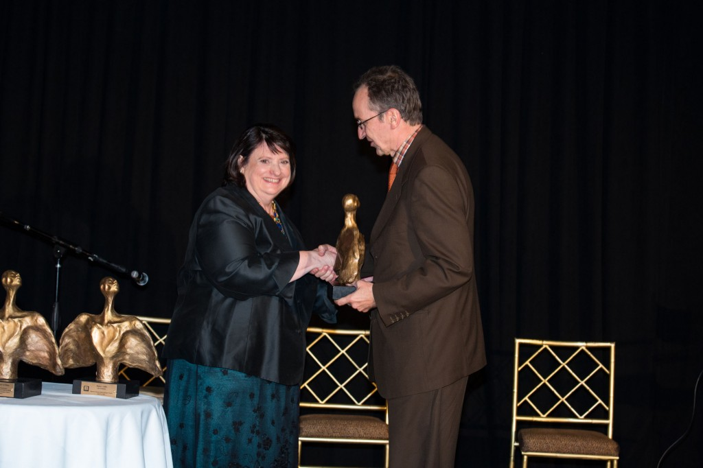 UN Women's Antonie DeJong accepts Bpeace's PIONEER GAMECHANGER award from Toni Maloney at our 10th anniversary Gala.