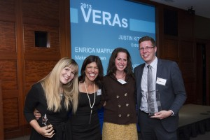 At Bpeace's 2013 Annual Meeting, Justin Kitchens (right) receives the Extreme Cycler Award for being the top Pedal for Peace fundraiser. Award presented by Bpeace Board Director Mary Ciampa (second from left). Also pictured: Volunteer Excellence Recognition Award (VERA) winners Jamie Mittelman (second from right) and Enrica Maffucci (left) honored for their work in making our 2013 Pedal for Peace ride the largest in Bpeace history.